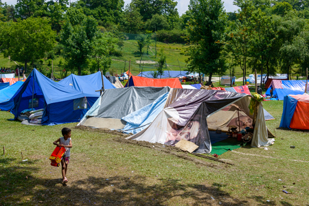 12 13: KATHMANDU, NEPAL - MAY 13, 2015: The Nepal Golf Course is used as a makeshift campsite after a 7.3 earthquake hit Nepal on May 12, 2015.