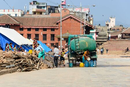 quake: KATHMANDU, NEPAL - MAY 14, 2015: At Durbar Square a truck brings water to people forced to live in tents after two earthquakes hit Nepal.