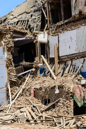 the aftermath: KATHMANDU, NEPAL - MAY 14, 2015: Gaddi Durbar palace on Durbar Square is severely damaged after two major earthquakes hit Nepal in the past weeks.