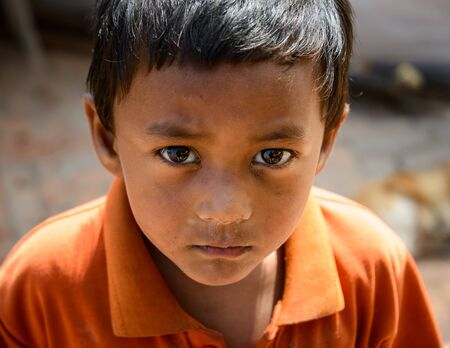 richter: KATHMANDU NEPAL  MAY 14 2015: A young Nepalese boy living in a  makeshift campsite after two major earthquakes hit Nepal in the past weeks. Editorial
