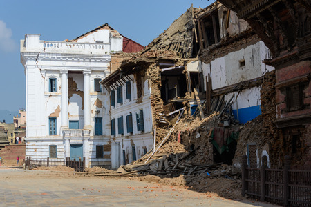 severely: KATHMANDU, NEPAL - MAY 14, 2015: Gaddi Durbar palace on Durbar Square is severely damaged after two major earthquakes hit Nepal in the past weeks.