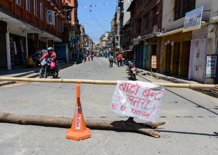 quake: KATHMANDU, NEPAL - MAY 14, 2015: Sign reads street closed, danger because of damaged buildings after two major earthquakes hit Nepal in the past weeks.