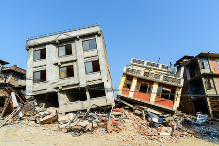 richter: KATHMANDU, NEPAL - MAY 22, 2015: Two partially collapsed buildings after two major earthquakes hit Nepal on April 25 and May 12, 2015.