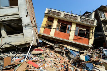 quake: KATHMANDU, NEPAL - MAY 22, 2015: Two partially collapsed buildings after two major earthquakes hit Nepal on April 25 and May 12, 2015.