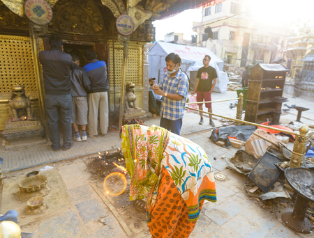richter: KATHMANDU, NEPAL - MAY 22, 2015: People praying at Swayambhunath which was severely damaged after two major earthquakes hit Nepal on April 25 and May 12, 2015.