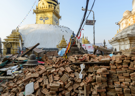 severely: KATHMANDU, NEPAL - MAY 22, 2015: Swayambhunath, a UNESCO World Heritage Site, was severely damaged after two major earthquakes hit Nepal on April 25 and May 12, 2015.