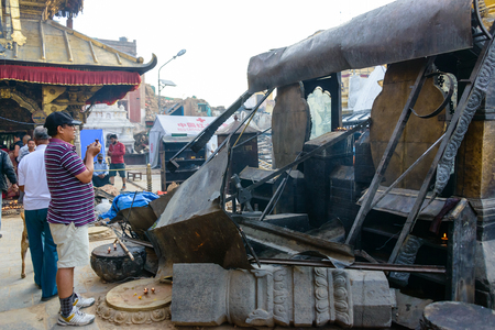 richter: KATHMANDU, NEPAL - MAY 22, 2015: Swayambhunath, a UNESCO World Heritage Site, was severely damaged after two major earthquakes hit Nepal on April 25 and May 12, 2015.