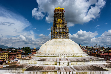bodnath: KATHMANDU, NEPAL - 24 JULY, 2015: Bamboo scaffolding is set up on the top of Boudhanath stupa in order to repair the damages caused by the Nepal earthquake of April 25, 2015. Editorial