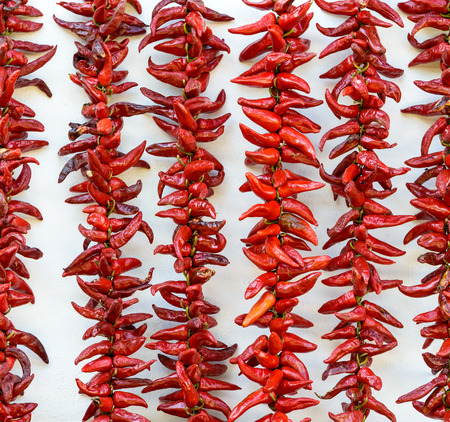 apo: Strings of PDO Espelette chilli peppers drying