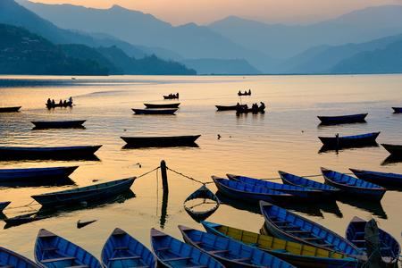 pokhara: Sunset on Phewa Lake in Pokhara, Nepal Stock Photo