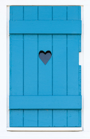 heart background: Blue wooden shutter with a carved heart