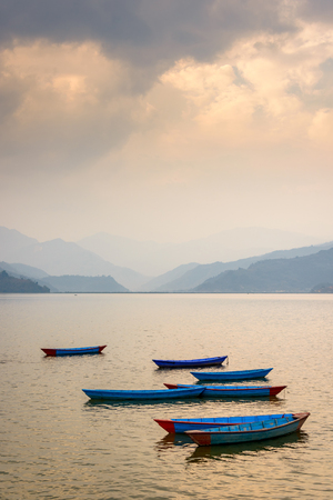 phewa: Sunset on Phewa Lake in Pokhara, Nepal Stock Photo
