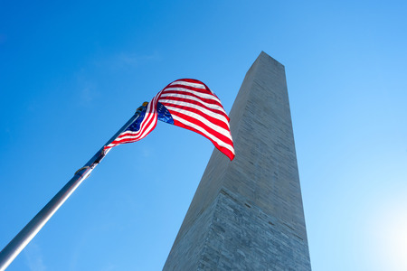 american history: The Washington Monument and an US flag Stock Photo