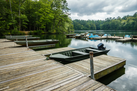 wooden dock: Aluminium bass fishing boat at wooden dock in Virginia, America USA