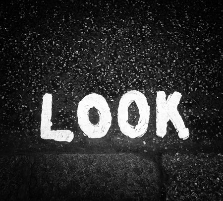 kerb: Look sign painted on the street in black and white