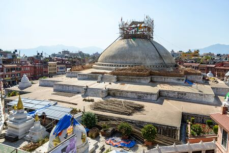 reconstructed: KATHMANDU, NEPAL - OCTOBER 3, 2015: After experiencing strucural damages due to the April 25th earthquake, the top of Boudhanath stupa is being dismantled. It will be reconstructed as before. Editorial