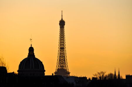 institute: The Eiffel Tower and the French Institute at sunset in Paris, France