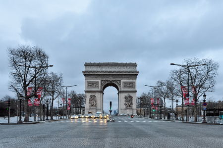 charles de gaulle: PARIS, FRANCE - CIRCA MARCH 2010: Quiet early Sunday morning on the Champs-Elyses and the Arc de Triomphe.