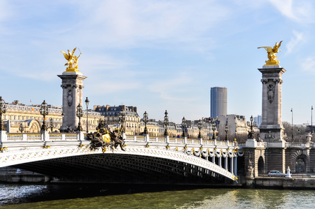 street lamps: Pont Alexandre III and Montparnasse Tower in the background in Paris, France Editorial