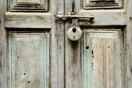old doors: Old wooden door shut with a lock in Kathmandu, Nepal