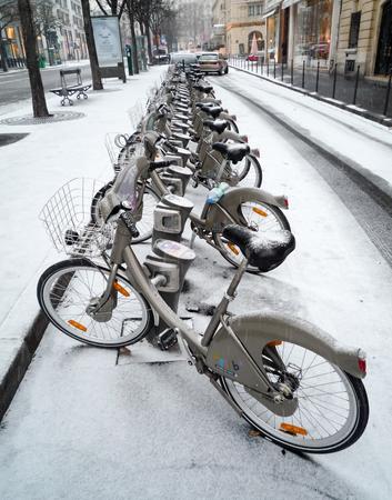 v cycle: PARIS, FRANCE - CIRCA JANUARY 2010: A Velib station after a snow fall.