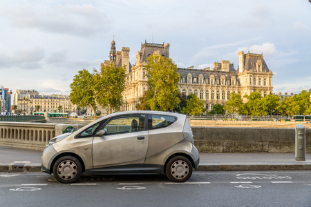 dirty car: PARIS, FRANCE - CIRCA AUGUST 2015: An Autolib is parked at an Autolib station and charging point. Autolib is an electric car sharing service. Editorial