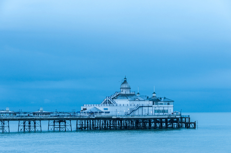 blue hour: Eastbourne pier in UK, blue hour light Stock Photo