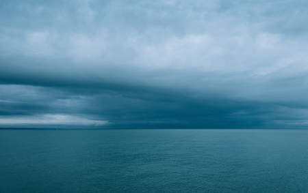 emulation: Cloudy and minimalist seascape, film emulation filter applied