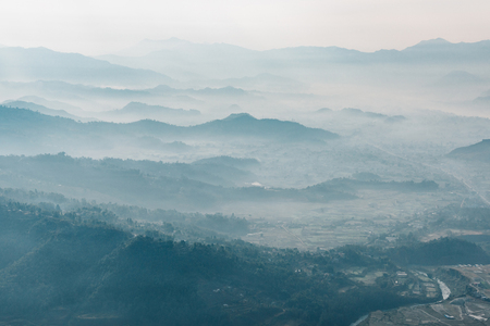 emulation: Aerial view of a misty morning near Pokhara, Nepal. Film emulation filter applied. Stock Photo
