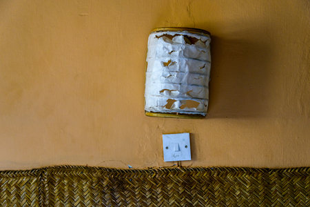 switch: Flush mount wall lamp, torn paper Stock Photo