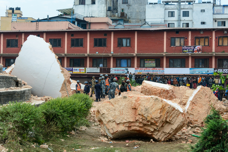 civilians: KATHMANDU, NEPAL - APRIL 26, 2015: Nepal Armed Police Force, army, police and civilians start rescue efforts at the collapsed Dharahara tower after the magnitude 7.8 earthquake on 25 April 2015. Editorial