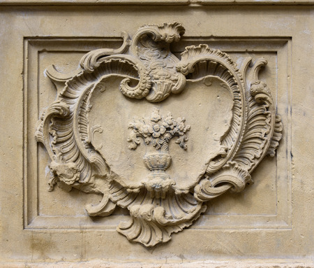 inset: Straight on close up of elegant old classical style stone relief with decoration in rectangle