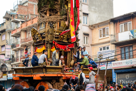 worshiped: PATAN, NEPAL - MAY 19, 2016: God of rain Rato Machhindranath chariot festival. Rato Machhindranath is worshiped as the god of rain. The chariot is pulled through the street of Patan for about a month.