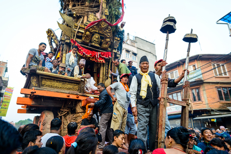 chariot: PATAN, NEPAL - MAY 19, 2016: God of rain Rato Machhindranath chariot festival. Rato Machhindranath is worshiped as the god of rain. The chariot is pulled through the street of Patan for about a month.