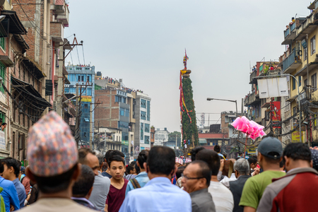 worshiped: PATAN, NEPAL - MAY 10, 2016: God of Rain Rato Machhindranath chariot festival. Rato Machhindranath is worshiped as the god of rain. The chariot is pulled through the street of Patan for about a month.