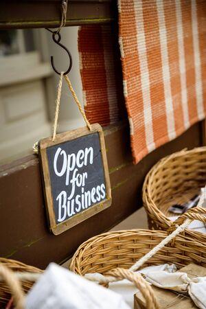 open business: Open for business slate sign at a vintage looking shop Stock Photo