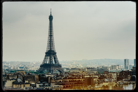 darkroom: The Eiffel Tower in Paris, France. Vintage look with film grain, darkroom style frame, and light leak.