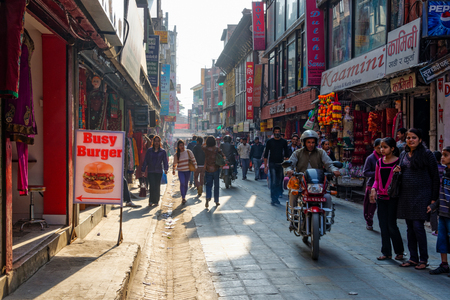 KATHMANDU, NEPAL - CIRCA APRIL 2013: A busy street in Asan area. Editorial