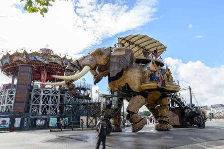 NANTES, FRANCE - CIRCA SEPTEMBER 2015: The Great Elephant goes for a walk with passengers aboard. Editorial