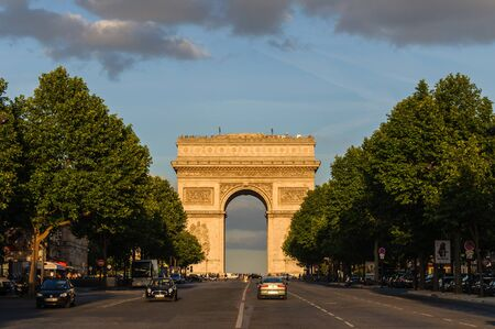 Arc de Triomphe: PARIS, FRANCE - CIRCA JUNE 2012: The Arc de Triomphe at sunset as seen from Avenue de la Grande Armée.