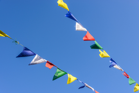 fastened: Prayer flags on blue sky in Nepal Stock Photo