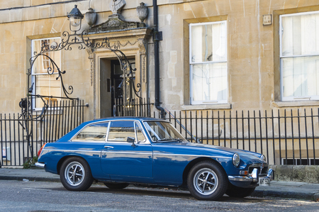 gt: BATH, UK - CIRCA OCTOBER 2011: A blue MGB GT parked in the street.