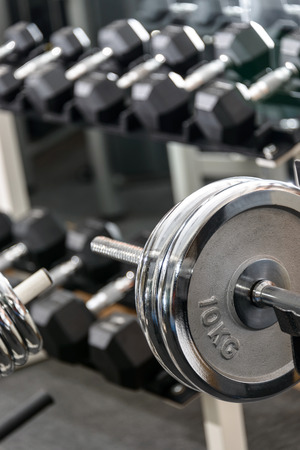 circular muscle: Dumbbells in a gym, sport concept Stock Photo
