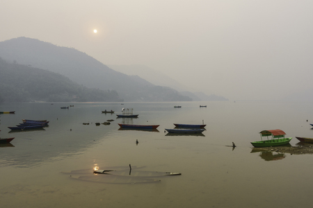phewa: Phewa Lake by a hazy day in Pokhara, Nepal