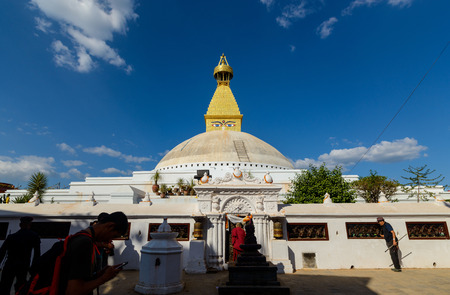 rebuilt: KATHMANDU, NEPAL - NOVEMBER 1, 2016: Boudhanath stupa rebuilt process is almost over, inauguration is scheduled for November 20, 2016. The stupa was damaged in 2015 by the Nepal earthquake.