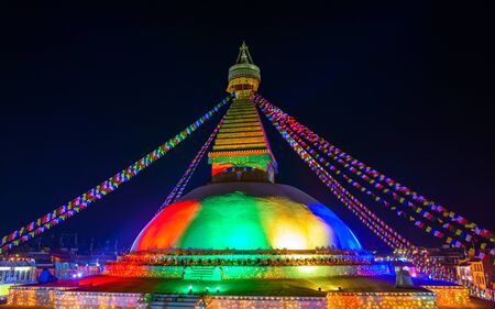 bodnath: Renovated Boudhanath stupa lit for its inauguration in Kathmandu, Nepal