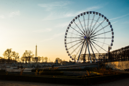 The ferris wheel and the Eiffel Tower in Paris, France Stock Photo