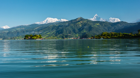 tal: The Machapuchare and Annapurna range seen from Phewa Lake in Pokhara, Nepal