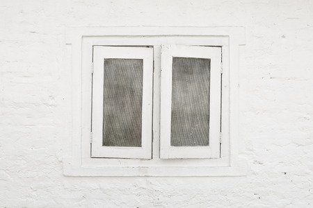 renovated: White window and white brick wall