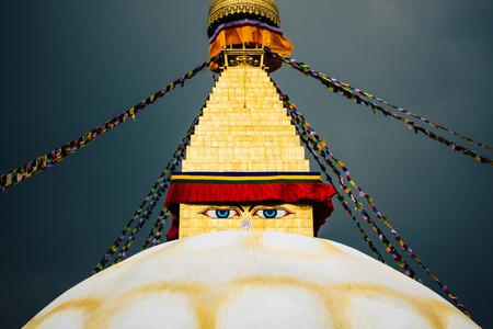Boudhanath stupa in Kathmandu, Nepal. Stormy clouds in the background.